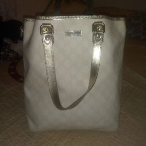Authentic Gucci handbag GG whites and silver